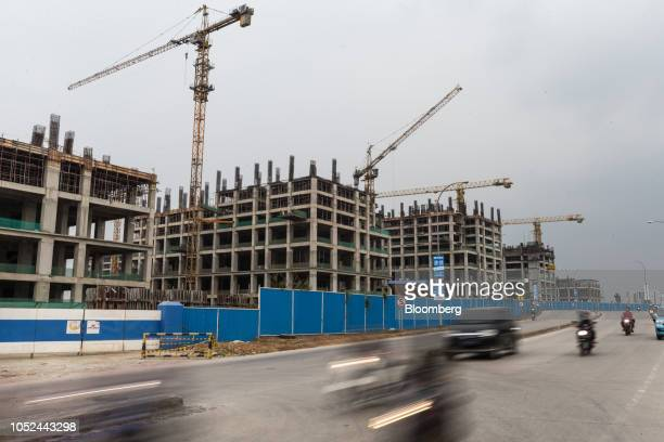 Cranes stand above buildings at the under construction Meikarta project developed by Lippo Group in Bekasi Regency West Java Province Indonesia on...