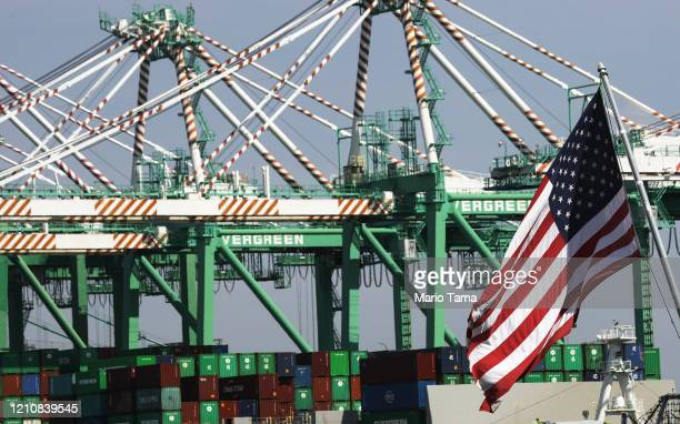 Cranes stand above shipping containers at the Port of Los Angeles which is the nation's busiest container port on March 6 2020 in Terminal Island...