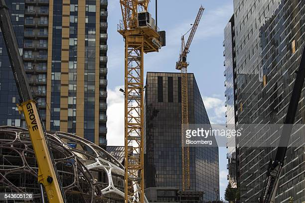 Cranes stand at a construction site for the Amazoncom Inc headquarters in Seattle Washington US on Wednesday June 15 2016 Amazoncom Inc is building...
