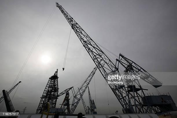 Cranes stand at Mitsubishi Heavy Industries Ltd's Honmoku plant in Yokohama city Kanagawa prefecture Japan on Wednesday June 15 2011 Nippon Yusen KK...