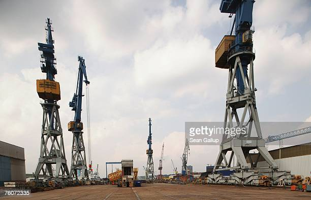 Cranes stand at the Blohm Voss shipyard August 13 2007 in Hamburg Germany Northern Germany with its busy ports of Hamburg Bremerhaven and Kiel is a...