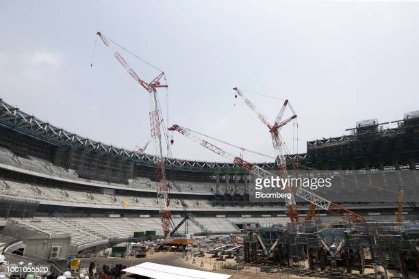 Cranes stand at the construction site of the New National Stadium the main venue for the Tokyo 2020 Olympic and Paralympic Games in Tokyo Japan on...