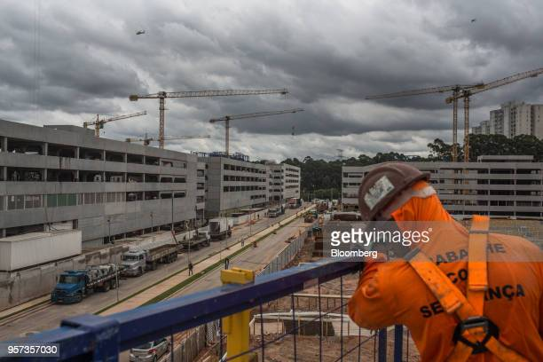 Cranes stand at the construction site of the Reserva Paulista residential complex in Sao Paulo, Brazil, on Wednesday, March 21, 2018. The world's...