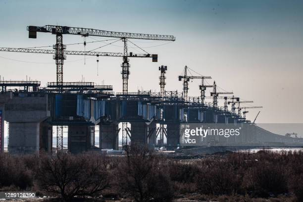 Cranes stand at the construction site of Zhaojun Yellow River Bridge on December 2, 2020 in Baotou, Inner Mongolia Autonomous Region of China.