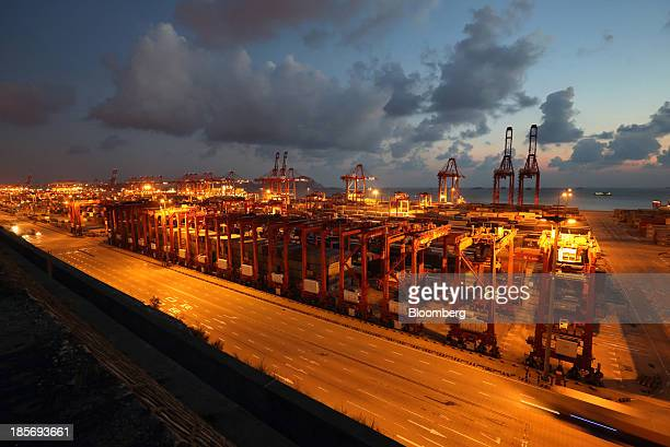 Cranes stand at the Yangshan Deep Water Port part of China Pilot Free Trade Zone's Yangshan free trade port area at night in Shanghai China on...
