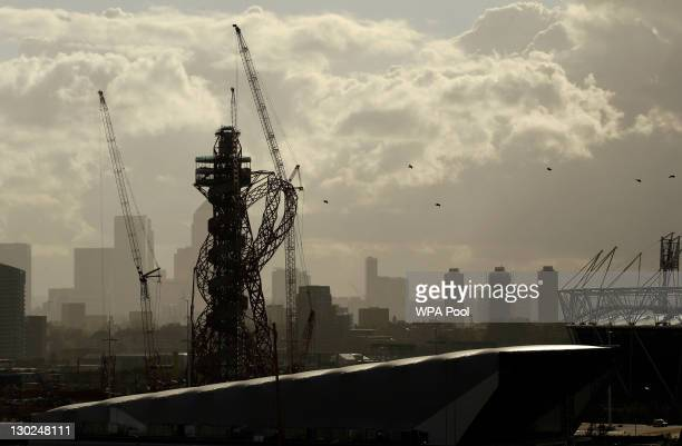 Cranes stand beside the Indian-born British artist Anish Kapoor's 'Orbit' tower beside the main 2012 Olympic stadium as the Canary Wharf business...