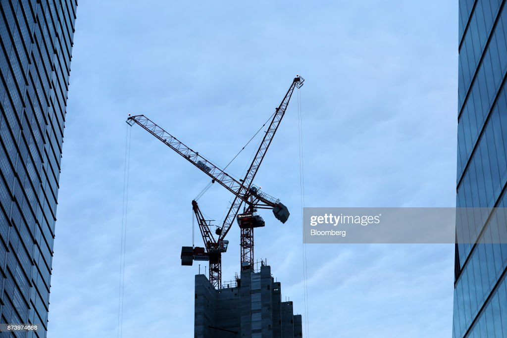 Cranes stand between high rise buildings in City of London, U.K., on Monday, Nov. 13, 2017. Investors spent 12.5 billion pounds on central London commercial property in the nine months through September, 44 percent more than a year earlier and the most since 2007, according to data compiled by broker Jones Lang LaSalle Inc. Photographer: Luke MacGregor/Bloomberg via Getty Images