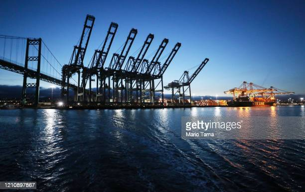 Cranes stand idle at the Port of Los Angeles, which is the nation's busiest container port, on March 6, 2020 in San Pedro, California. The ports of...