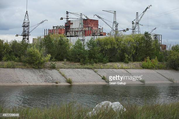 Cranes stand in the same position as nearly 30 years ago over the abandoned construction site of reactors five and six of the Chernobyl nuclear power...