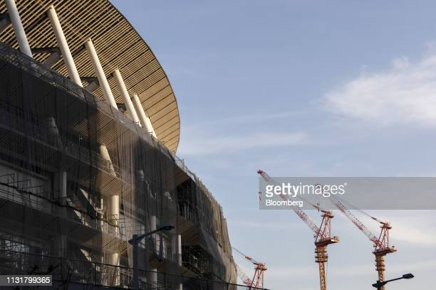 Cranes stand near the construction site of the New National Stadium the main venue for the Tokyo 2020 Olympic and Paralympic Games in Tokyo Japan on...
