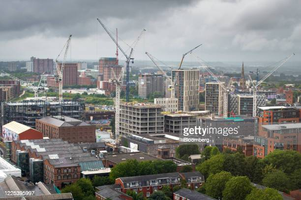 Cranes stand on construction sites in the skyline of central Manchester, U.K., on Tuesday, July 7, 2020. U.K. Chancellor of the Exchequer Rishi Sunak...