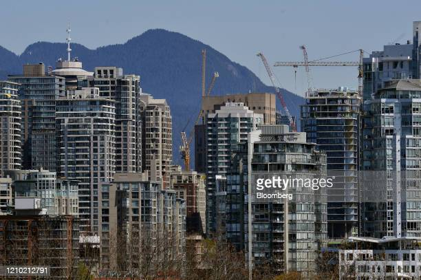 Cranes stand over residential buildings in Vancouver British Columbia Canada on Thursday April 16 2020 As its oil sector shriveled in recent years...