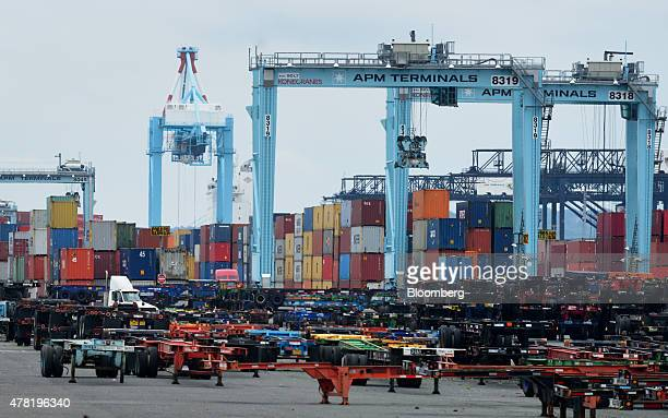 Cranes stand past empty trailers at the Port of Newark in Newark New Jersey US on Thursday June 18 2015 The US Senate paved the way for a final vote...
