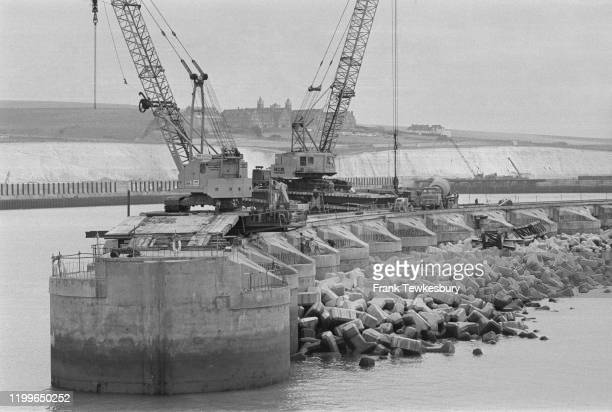 Cranes supported on piers during construction of the Thames Flood Barrier on the River Thames London August 1976