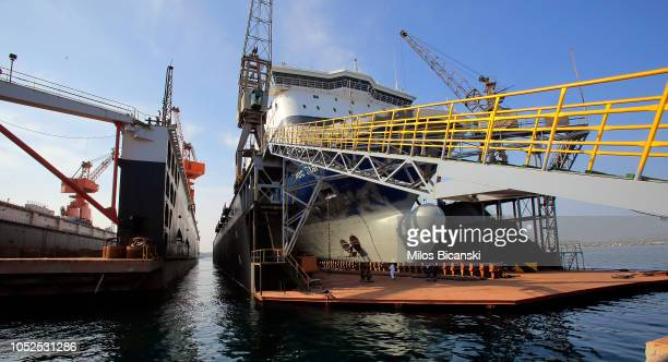 Cranes surround a ship at a new dry dock at the shipyards at the port of Piraeus on October 19, 2018 in in Piraeus, Greece. Chinese shipping giant...