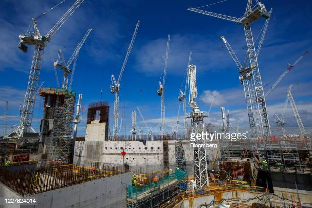 Cranes surround Reactor Unit One at the construction project for Hinkley Point C nuclear power station, operated by Electricite de France SA , near...