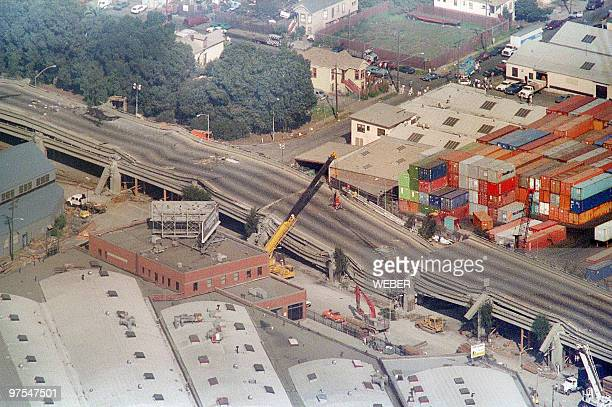 Cranes surround the Cypress Structure on Interstate 880 19 October 1989 in San Francisco following the earthquake estimated at 69 on the Richter...