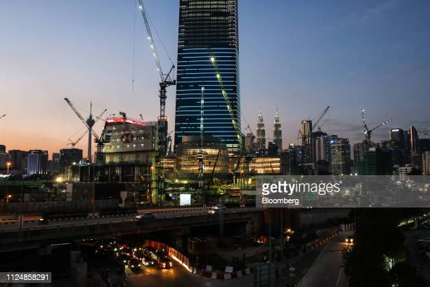 Cranes surround the under construction Exchange 106 building center on the site of the Exchange TRX precinct in Kuala Lumpur Malaysia on Tuesday Feb...