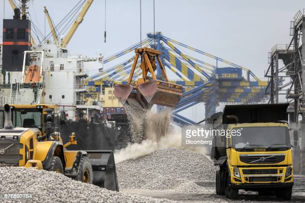Cranes unload limestone on to the dockside from a ship not pictured at Krishnapatnam Port in Krishnapatnam Andhra Pradesh India on Monday Aug 11 2017...