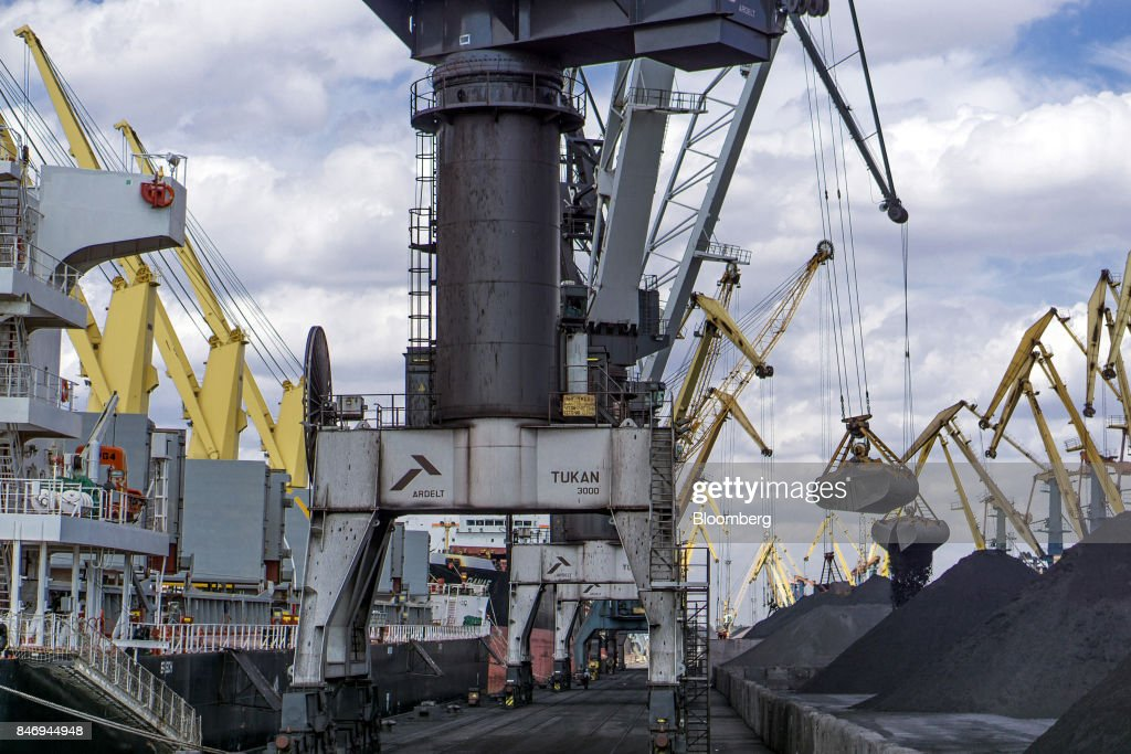 Cranes unload the first shipment of anthracite coal from U.S. supplier XCoal Energy & Resources LLC, for state energy firm Centrenergo PJSC, onto the dockside at Yuzhny Port, near Odessa, Ukraine, on Wednesday, Sept. 13, 2017. A Pennsylvania company will send 700,000 tons of coal to Ukraine in a deal the administration of President Donald Trump heralded as an important tool to undercut the power Russia has over its European neighbors. Photographer: Vincent Mundy/Bloomberg via Getty Images