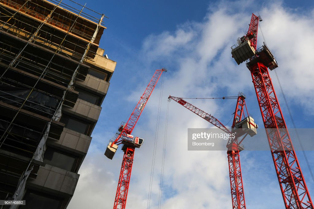 Cranes, with the logo of building contractor Carillion Plc, stand on a construction site in London, U.K., on Wednesday, Jan. 10, 2018. U.K. ministers are said to have met over the possible demise of Carillion, according to the Financial Times, without saying where it got information. Photographer: Luke MacGregor/Bloomberg via Getty Images