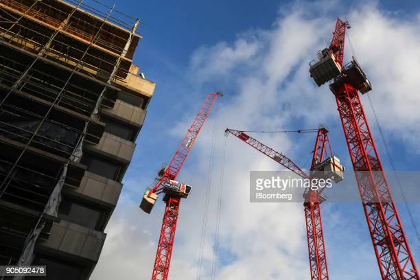 Cranes with the logo of building contractor Carillion Plc stand on a construction site in London UK on Wednesday Jan 10 2018 Carillion Plc a UK...