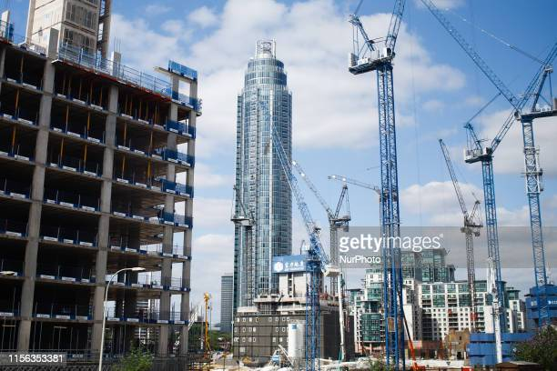 Cranes work on a construction site near to the 50storey St George Wharf Tower in the Vauxhall area of London England on July 15 2019 Research by the...