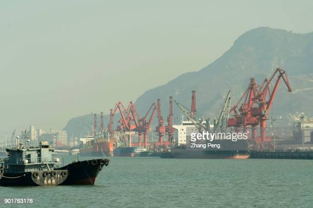 Cranes work on Lianyungang port Lianyungang a coastal city beside Yellow Sea of China as the east starting point of the new Eurasian Continental...