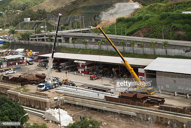 cranes working at metro station construction - fstoplight stock photos and pictures