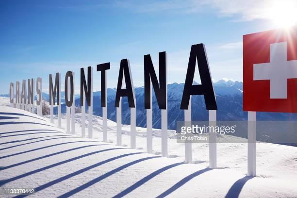 crans montana sign in the mountains with swiss flag - crans montana - fotografias e filmes do acervo
