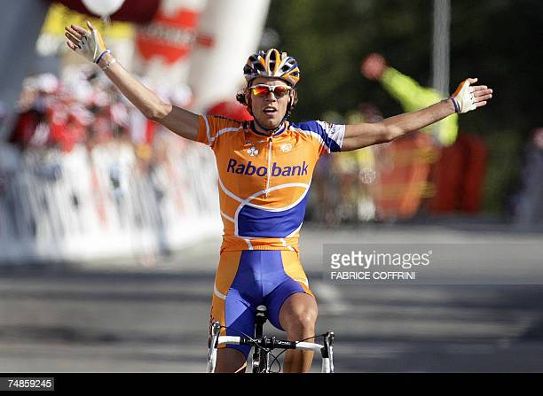 4e1d1a363 Dutch rider Thomas Dekker raises his arms in victory as he crosses the  finish line of