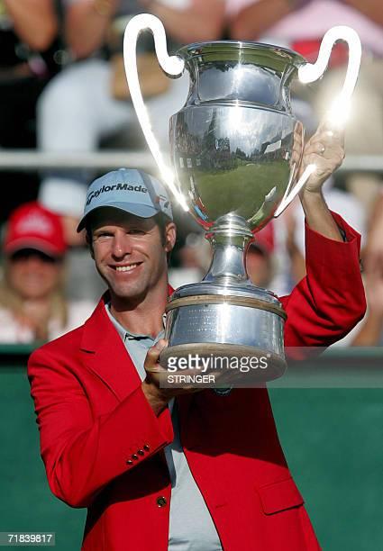 Welsh Bradley Dredge holds the trophy after winning the EPGA Golf European Master in CransMontana 10 September 2006 AFP PHOTO / DOMINIC FAVRE