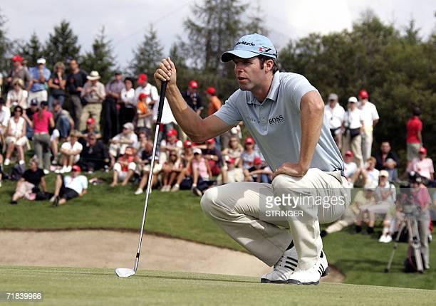 Welsh Bradley Dredge looks at the ball 10 September 2006 on the seventh hole during the final round of the EPGA Golf European Master in CransMontana...
