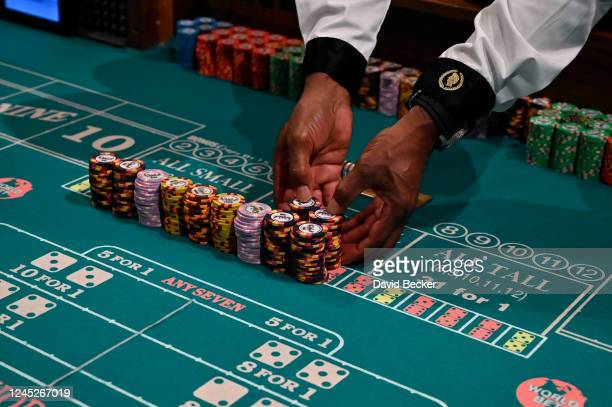 Craps dealer prepares stacks of casino chips at Caesars Palace on the Las Vegas Strip as the property opens for the first time since being closed on...