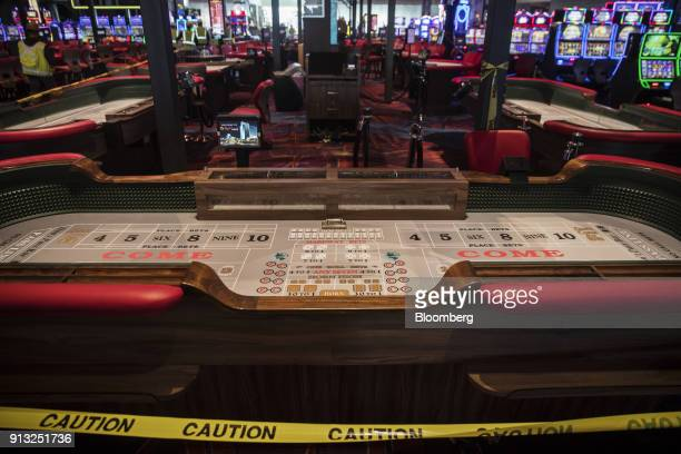 A craps table sits behind the caution tape on the gaming floor of the Resorts World Catskills casino hotel and entertainment complex operated by...