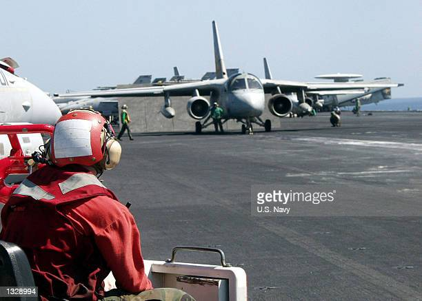 Crash and Salvage Team member observes flight operations on the flight deck October 23, 2001 aboard the aircraft carrier USS Carl Vinson. The Carl...