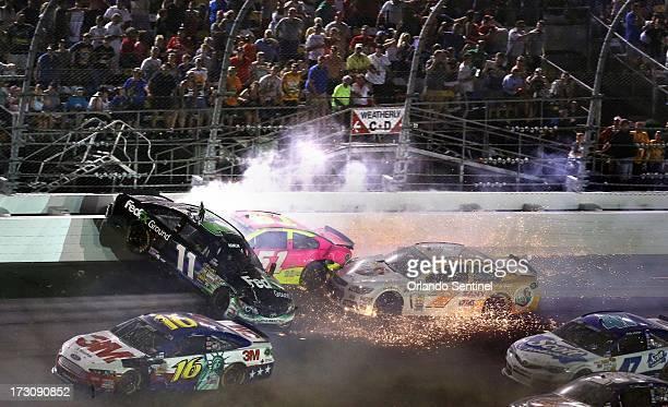 A crash on Lap 149 sends Danny Hamlin airborne near the finish line during the Coke Zero 400 at Daytona International Speedway on Saturday July 6 in...