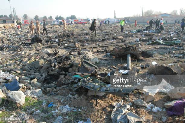 Crash site of a Ukrainian airliner that burst into flames shortly after take-off from Tehran on Wednesday, killing all 176 people aboard in a crash.