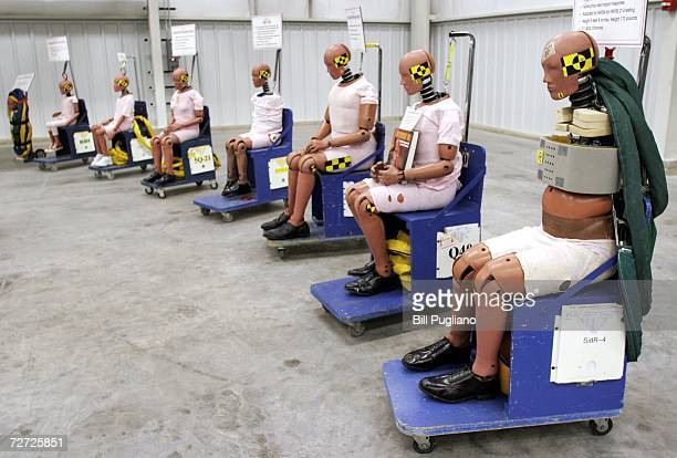Crash test dummies sit on display at General Motors' new $10 million crash testing center December 5 2006 in Milford Michigan GM announced that...
