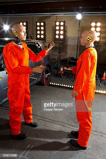A crash test dummy holding keys out to another crash test dummy