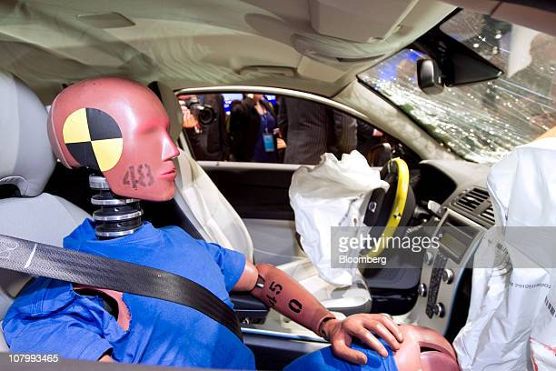 A crash test dummy sits in a Volvo Cars electric vehicle that was testcrashed and is on display at the North American International Auto Show in...