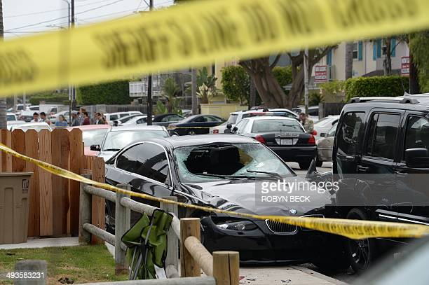 A crashed car allegedly driven by a gunman sits partly on the sidewalk on May 24 2014 in Isla Vista California a beach community next to the...