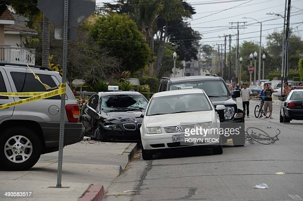 Crashed car , allegedly driven by a gunman, sits partly on the sidewalk on May 24, 2014 in Isla Vista, California, a beach community next to the...