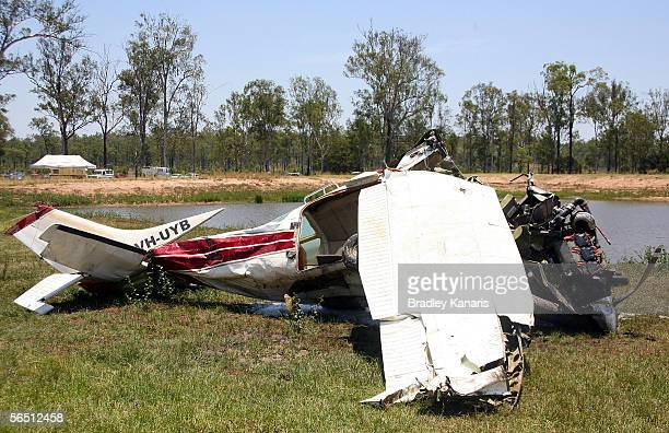 A crashed Cessna 206 is pictured after it was pulled out of a catchment dam January 3 2006 in Ipswich Australia The aircraft crashed into the dam on...