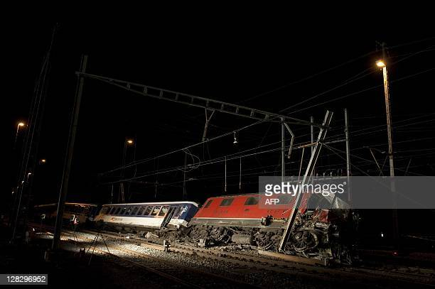 A crashed train lays on its side after a collision onOctober 6 2011 near Olten northern Switzerland A collision between two passenger trains caused...
