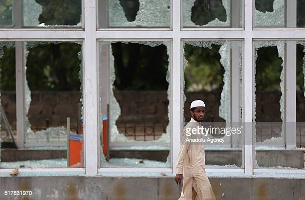 A crashed window near parliament house where thousands of protesters who managed to reach the area commonly known as red zone is seen as supporters...