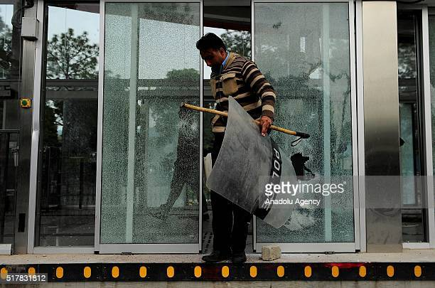 A crashed window of a metro station near parliament house where thousands of protesters who managed to reach the area commonly known as red zone is...