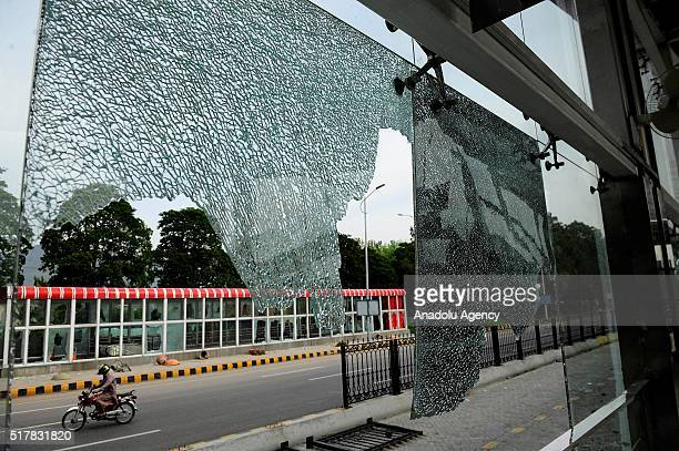 """Crashed window of a metro station, near parliament house where thousands of protesters who managed to reach the area, commonly known as """"red zone"""",..."""