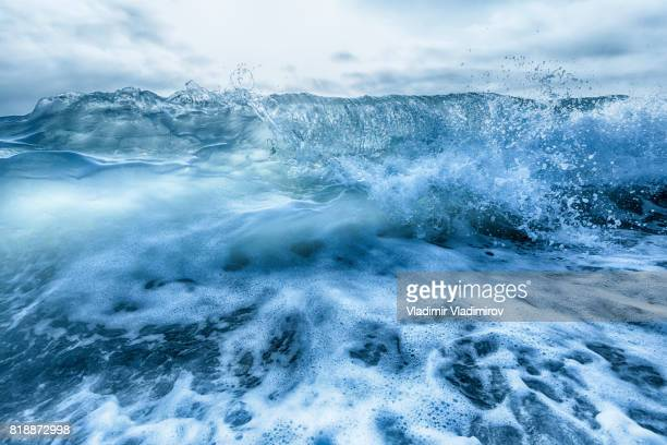 crashing blue and white waves - gale stock photos and pictures