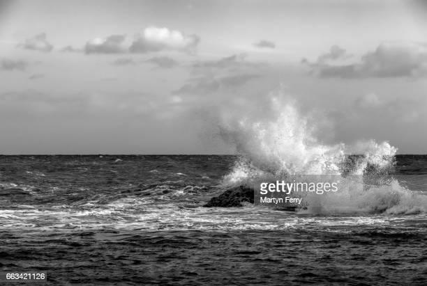 Crashing monochrome wave, Man O'War Bay, Lulworth, Isle of Purbeck, Dorset, UK